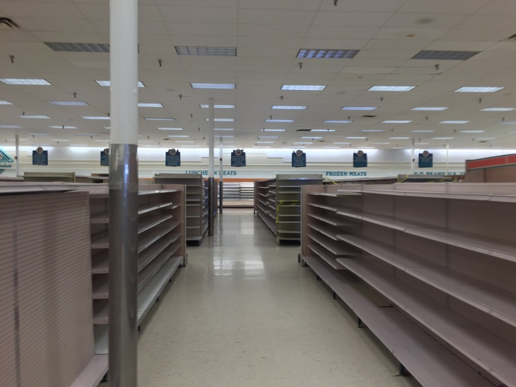 Empty_shelves_in_a_closing_Winn-Dixie (1)